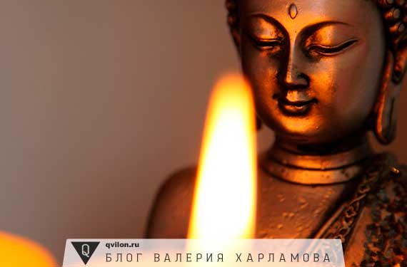 статуэтка будды и свеча