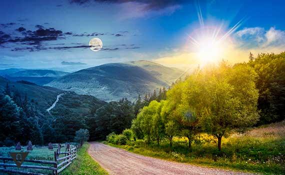 солнце и луна на фоне леса и гор