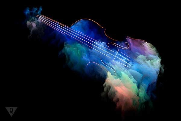Музыка нарисованная абстрактными красками и музыкальным инструментом