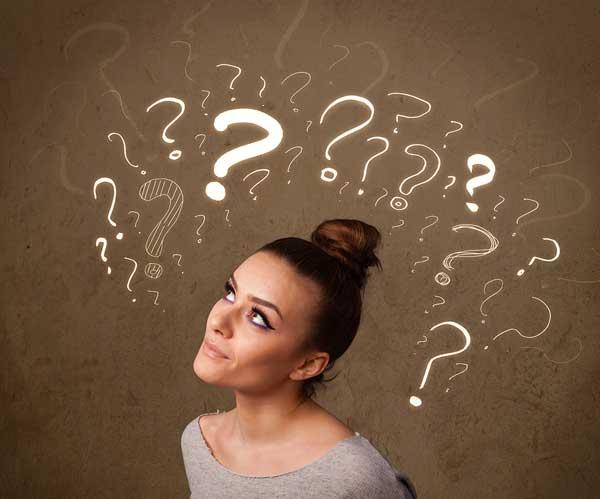 Девушка и знаки вопроса над головой