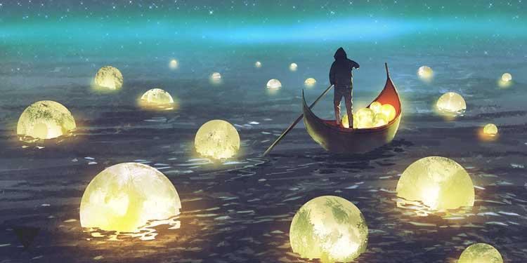Человек плывет в лодке среди светящихся шаров.